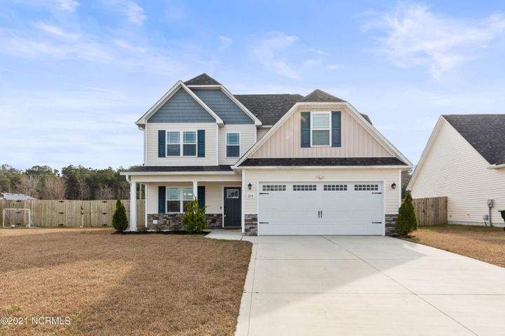 This is the ever popular Chelsea floorplan by Atlantic Construction, situated perfectly in the conveniently located neighborhood of Bridgeport in Sneads Ferry. Close to Camp Lejeune, MARSOC, and Stone Bay. Not to mention, minutes away from the Topsail beach! Downstairs you will find an open concept floorplan, with a large living room that flows into the kitchen and dining room. The kitchen features stainless steel appliances, backsplash, large island, and granite countertops! Downstairs is all wood vinyl flooring, so no worries about having carpet in your main living areas! Upstairs are 3 additional bedrooms, and laundry room. The Master Suite has his and her sinks, a separate soaking tub, stand-up shower, and walk-in closet. Off the walk-in closet, you will find an extra room for walk-in storage! The backyard is large and complete with a grilling patio and fenced-in with a wooden privacy fence. This neighborhood also features a community pool. Don't miss out on your chance to call this HOME!