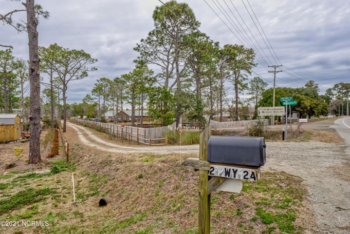 Great 2.35 acre lot with private driveway. Well and Septic on site along with Double Wide on permanent foundation. Doublewide is sold as-is and need some minor updates. 3 outbuilding include, wired shed, storage shed and well pump house. 10 min to Bogue Sound and 20 minutes to Atlantic Beach and Emerald Isle. Backs to Wildlife Preserve.