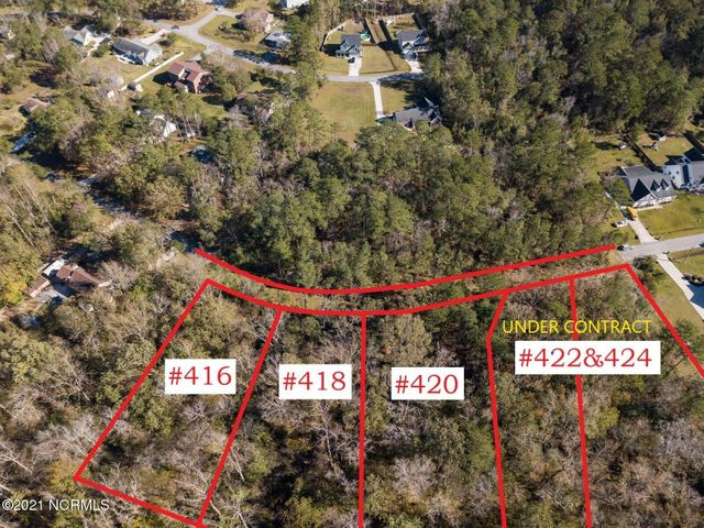 Build or invest in one of 9 undeveloped lots offered for sale on the southwest side of Jacksonville NC! Totaling over half an acre, this parcel is not in city limits, and has minimal protective covenants but NO HOA! The seller had topo and boundary surveys completed, as well as soil evaluations, ask for a copy of the maps to review. This lot does back up to Flat Bottom Branch, and there is some flood hazard area on the back side, but there is high land to work with! If you are a builder, put a spec home up with good floorplan priced right and it will sell with this awesome location. Candlewood is a state maintained road, according to the DOT website, so there may be hope for this section of unpaved, undeveloped road to be taken over by the state if improved. Call a Realtor today for more information on this opportunity!