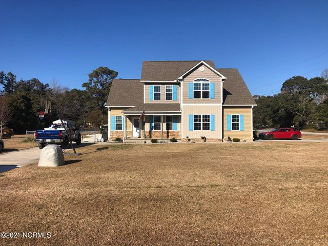This must see family home with fantastic water views and deeded waterfront access is perfect for anyone that who enjoys the water and everything it has to offer from fishing, kayaking, and swimming. From your front porch,enjoy views of Bogue Sound. The main level has a open floorplan with living room, dining room , kitchen, half bath and laundry room. The large open master bedroom has a big ensuite bath with granite double vanity, linen closet, and huge walk in closet. Upstairs you will find three bedrooms and full bath with tub/shower and granite countertop. Plus a big bonus room with walk in access to plentiful storage in the attic. From the kitchen french doors open out to your screened in porch perfect for enjoying your morning coffee or an evening with friends and family. The deck on the rear of the house has a built in table and benches perfect for grilling out and enjoying the fresh air. As you walk across the backyard you can take a dip in your above ground pool surrounded by another deck perfect for sun and fun. As the sun goes down, light a fire in the fire pit surrounded by five swings with seating for eight. Roast some marshmallows and enjoy. It doesn't end there either. This home has anattached garage with concrete parking for two, and a second driveway that leads to the  20x25 detached garage/workshop in the back yard with plenty of parking for your boat,,RV, or both.