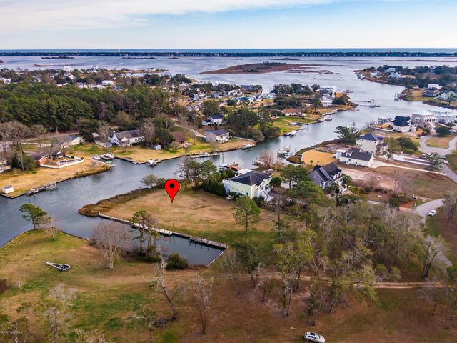 Beautiful, waterfront lot in Cape Point ready for your dream home at the coast! Reinforced concrete bulkhead and a boat dock (6' x 40') already in place for your boat. This location offers easy access to Bogue Sound and the ICW. Award winning Croatan School District.  Cape Point offers: Clubhouse, swimming pool and street lights. Expired 3 bedroom septic permit under documents.