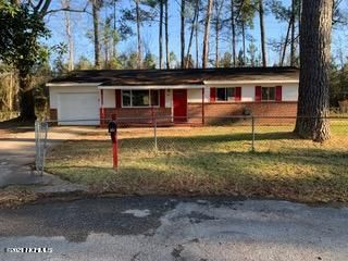 Lots of potential in this 3 bedroom, 1.5 bath home.  Located minutes from Jacksonville, just outside the city limits, you will be able to take advantage of the savings with county taxes.  Tucked back in a cul-de-sac this home has a fully fenced in yard. You have the opportunity to make this home yours - a bit of TLC will make this house a home.  The spacious living room offers tile flooring and is open to the dining area and kitchen.  The kitchen and dining area offers tile flooring, white cabinets and white appliances. Down the hall you will find all three bedrooms.  Opportunities abound with this home.