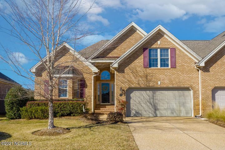 Come home to easy living at this immaculate brick townhome in Gardenwood of Brunswick Forest! This floorplan features 3 generously proportioned bedrooms, 3 baths, and an upstairs flex room and bath with possibilities for an extra bedroom or office space. As you walk in, you will be drawn to the well maintained hardwood floors, thick moldings, and handcrafted detail throughout. The open kitchen features a wall mounted oven & microwave, granite countertops, stainless steel appliances, and overlooks the living room with a tray ceiling and propane fireplace. Additional features include an extended master suite with a sitting room and tray ceiling, screened in porch, and patio for grilling or entertaining. As a resident of Brunswick Forest, you will have access to world class amenities including pools, tennis courts, fitness centers, basketball and pickle ball courts, playground, dog parks, a kayak launch, walking trails, and more. Plus, enjoy the prime location of this community with just a short drive to Historic Downtown Wilmington, and the beautiful beaches of Brunswick County. Don't miss this gem!