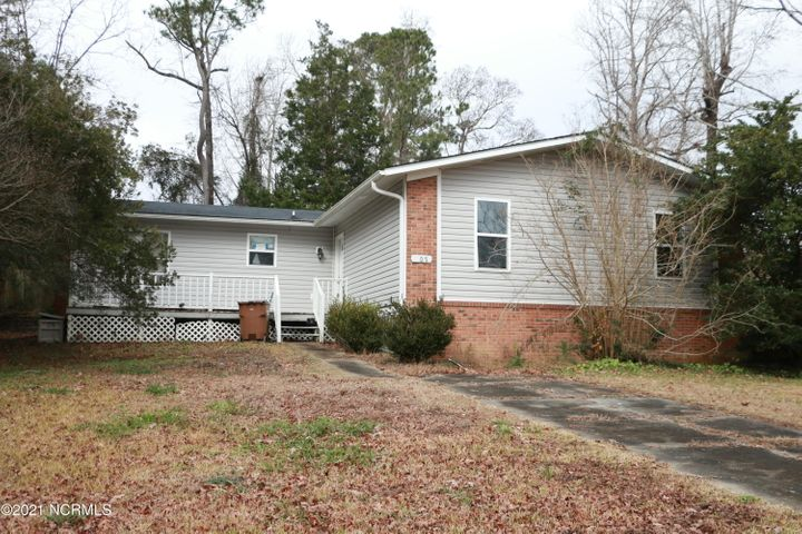 Great investment opportunity! This is a 4-bedroom home with two full bathrooms that suffered damage during Hurricane Florence. Don't worry, the tree has since been removed! Smooth igneous rock countertops (aka granite) adorn the kitchen lower cabinets.The wood burning fireplace in the den would be a cozy way to relax after a long day. Don't let this home's sad appearance scare you away--it has a lot of potential for the right buyer! Flip and sell or use it as a rental.