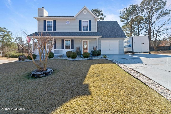 Well maintained and updated home located in Jacksonville NC. First floor features wood tile flooring in living room with a fireplace, updated kitchen, 1/2 bath and dinning room. Upstairs you will find updated full bath with new vanities, tile shower/jacuzzi tub combo, three bedrooms with updated master bathroom. The backyard has a oversize deck that leads to the covered back seating area and includes a privacy fence around the backyard.Updated features- newer roof, heat pump-AC system, water heater, new sliding glass door to the backyard, new door from garage to backyard.