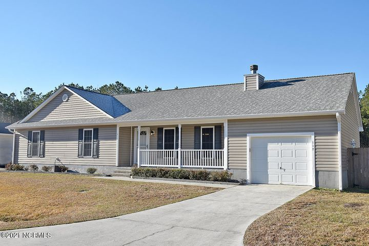 How fantastic is this home? A 3 bedroom, 2 bath, one-story home on .82 acre lot super close to the military bases of Camp Lejeune and New River Air Station. The home has fresh paint and new carpet in the bedrooms. Easy maintenance, solid-surface flooring runs throughout the rest of the home. Enjoy the wood burning fireplace as you relax under the vaulted ceiling in your living room. Plenty of cabinet and counter top space in the kitchen helps with easy meal prep. An adjacent laundry closet is complete with washer/dryer. The owners' retreat offers an en suite bathroom offering plenty of space on the dual vanity and beautiful large beveled mirror. Relax in the garden tub/shower combo under the skylight. You will have plenty of storage with a one car garage and pull down stairs to the attic space above. The roof is three years young and the HVAC was installed in 2015. No HOA dues and the subdivision sits outside the city limit. Relax and enjoy the expansiveness of the rear fenced yard.  There is even a playhouse with climbing wall for kids. Note that the lot does run past the back fence line. If you want a day at the beach, you are less than a half hour away to North Topsail. Only 15 minutes to Jacksonville for plenty of shopping and restaurants. The seller is offering a Choice Ultimate Home Warranty. This one won't last long!