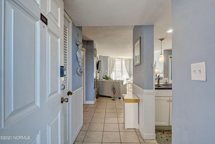 Welcome to this bright and beachy 2 bedroom/2 bathroom condo, located on the second floor of the middle building at the St. Regis Resort. This tasteful nautical themed condo is turn key and comes fully furnished, with upgraded kitchen and wet bar cabinets and countertops (installed in 2016), updated bathrooms with refinished bathtubs as of 2016 and a newer HVAC unit that was installed in 2019. The living room has a wall mounted TV along with a sound box and bar, while the master bedroom has a wall mounted TV as well. Spend time in the kitchen, which is fully stocked with nautical themed dishes, utensils & more, while looking at the endless views out of the floor to ceiling sliding glass doors. Spend your days strolling the beach while watching the dolphins play and looking for prehistoric sharks' teeth. Be sure to end your evenings on your private balcony overlooking the proposed newly renovated indoor pool along with fantastic views of the Atlantic Ocean!Not only has this charming condo created many fun filled years of long lasting memories for the owners, it has also proven to be a fantastic rental with a gross income amount of $26,115 in 2018, $34,243 in 2019 and $28,250 in 2020 with confirmed rentals on the books for 2021!Whether you are looking for an investment property, or a home away from home, this condo has it all!