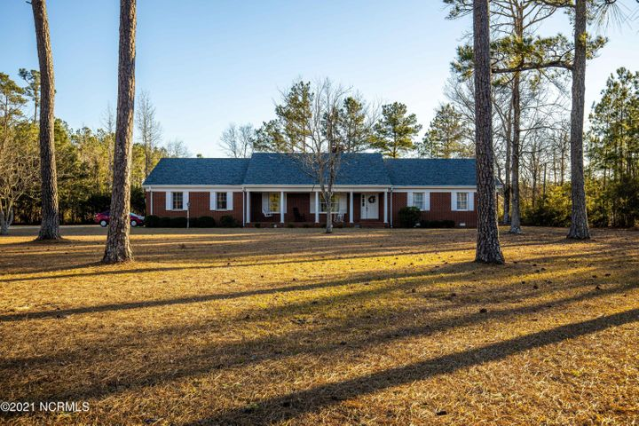 WE HAVE THE KEY to your future! A 3 BR, 2-bath brick ranch on a 1 acre+ site in the Swansboro school district. This home offers bright and spacious rooms, a cupboard-clad kitchen, formal dining room, a country-style  brick fireplace, an old-fashion front porch, two-car garage, and much more! This wonderful home is located minutes from Swansboro's shops and restaurants, Emerald Isle's beautiful beaches, and public boating access. Seller's are offering a $4,000 upgrade allowance! Call and you will see everything tomorrow offers at $250,000.