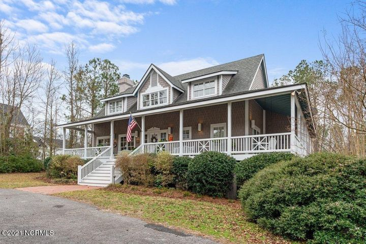 Rare opportunity to purchase a unique and stately home in waterfront community Forest Sound. This home features large wrap around porches, 20 ft by 40 ft in ground pool and a basement!  Basement square footage not included in heated square footage. Community picnic area, boat ramp and access to the intracoastal waterway.  Large 1.65 acre lot allows for a second home up to 50% of the square footage of the main home.  Convenient access door from the pool area to the basement.  This beautiful, well kept home was designed by the owner who is a professional architect.  Great Hampstead location and desirable Topsail school district.  This is the home and location you have been hoping would come along!