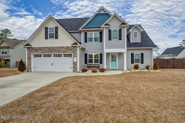 You can smell the Ocean from this beautiful Home! 3-miles to high-rise bridge, crossing to TOPSAIL ISLAND BEACHES, and 3.5-miles to PUBLIC BOAT RAMP to Intracoastal Waterway! Featuring a 1st-Floor Master, and a FOURTH BEDROOM upstairs if you use the bonus as a bedroom! The home sits on a primo .53-ACRE LOT in the back of the neighborhood w/ a GIGANTIC FENCED BACKYARD! Enjoy the class and energy of vaulted ceilings, w/ a flex formal dining area, or office. This is an upgraded floor-plan including an EXPANDED KITCHEN w/ entertainment island! Super close to Camp LeJeune and a quick trip to Wilmington or Jacksonville! Don't delay, book your tour now, VIRTUAL TOURS available!