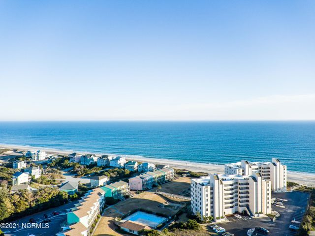 Imagine... owning a furnished waterfront condo in the gated subdivision of Sound of the Sea in Emerald Isle with views of the Atlantic Ocean from almost every room - you can even see the Bogue Inlet Pier! Watch the boats go, dolphins play in the waves and families make memories to last a lifetime from either of your two private balconies. Sit out here and enjoy a glass of wine, read a good book or just simply breathe the Coastal air and enjoy extraordinary Ocean views this amazing unit affords! And wait until you see the incredible sunrises and sunsets... This beautiful, recently remodeled, property is a 2 bedroom, 2.5 bath coveted 3rd floor unit with windows lining the living room and master bedroom bringing in ample natural light and the waterfront views you can only dream about. The unit has deeded parking space, significant storage/closet space and semi-private Atlantic Ocean beach access directly from the complex - don't forget about the amenities to include a community pool, tennis courts and boat storage on site. You'll also enjoy breathtaking views year round. This is truly a special place to call home!