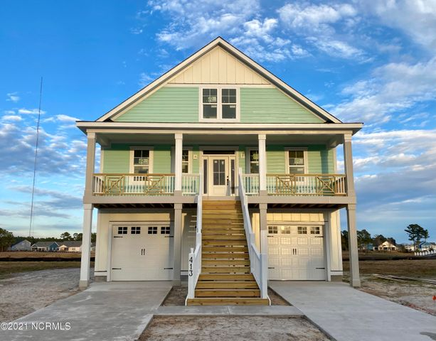 Coastal dream home in the areas hottest waterfront community. One of our most popular plans with family & functionality in mind. Perfect opportunity to make your own selections, paint colors and flooring.Smell the fresh salty air of the nearby ICWW from this gorgeous 4 bedroom, waterfront beach style home.On the first level a spacious foyer will greet you and lead to a large family room, guest quarters and full bath. Continue up the staircase to the bright and open main living area featuring 9' ceilings. The gourmet kitchen with custom detailed island, wood frame extending cabinetry with upper glass doors, custom detailed shiplap range hood, stainless steel appliances, farmhouse sink, granite countertops, tile backsplash and oversize pantry, flows effortlessly to the dining area and living room with gas fireplace, floating mantle, shiplap surround, built ins and french doors to expansive rear deck. The Master suite, with tray ceiling, features an oversized walk in closet with wood shelving, a ceramic tile shower and freestanding soaker tub with shiplap surround, double vanity and french doors to deck. Upstairs there are two additional bedrooms with a shared bath. There is plenty of outdoor living space including covered front and rear porches and an optional chefs dream outdoor kitchen, tons of storage, a laundry room and powder room on the main level to complete everything else on your wish-list. Other amenities include an upgraded coastal trim package and professional landscaping. Summerhouse amenities include 6 lakes, a huge clubhouse w/ billiard room, bar area and full kitchen, resort style swimming pool, fitness center, day docks, boat ramp & storage, tennis & basketball courts, 9 miles of running/hiking trails, playground, open air pavilion, multiple picnic area & fire pits. Get ready to fall in love with your dream home. Floor plans & renderings are solely representational.
