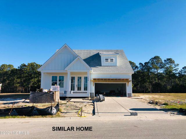 Welcome to the Meridian Floorplan in the Stunning Gated Waterfront Community of Summerhouse on Everett Bay located in Holly Ridge!  This new cottage style floorplan by Channel Marker Builders boasts a sprawling open floorplan with 3 Bedrooms, 2.5 Baths and upstairs loft.  The first floor of this stunning residence features 10 foot ceilings, a cathedral ceiling in the living room with cozy gas logs fireplace, gourmet kitchen with large island, plenty of cabinets and counterspace, dining nook, pantry, breathtaking master suite with private laundry access, and powder bath.  Enjoy beautiful views of your backyard through the oversized PGT Slider door which opens to a screened in back patio with views of Lake Willow.  This home boasts main level living at its finest featuring the owner suite on the main level boasting a gorgeous trey ceiling and is separate from the other two bedrooms.  The master bath offers a fully tiled walk-in shower, dual vanities, water closet, and walk-in closet! Upstairs you will find two large bedrooms both with walk in closets, Jack and Jill bath, and large open loft. Summerhouse on Everett Bay features six scenic lakes and the amenities include two gated entries into the community, Resort style community pool with lazy river, two tennis courts, breathtaking clubhouse, boat launch with direct access to the intracoastal waterway including day docks and pier, on-site boat storage, picnic areas, nature park with fire pit, walking trails, open air pavilion, playground, and fully equipped fitness center with lockers & showers. Perfectly located between Wilmington and Jacksonville and just minutes from Surf City, MARSOC, Camp Lejeune, Topsail Beaches, and Stone Bay. Channel Marker home designs boast the perfect blend of Southern Charm and Coastal Living architectural styles. Come home to extraordinary coastal living at its finest!