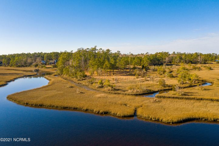Waterfront Estate property is available close to historic Swansboro. A rare and breathtakingly  beautiful opportunity to own almost 9 acres of panoramic waterfront with expansive views . You truly can have it all! Lots of room to spread out, horses, privacy but close to everything . Lovely mature trees, septic in ground, a lot of areas to plan...make yor dreams come true ! Call today for a tour and information.