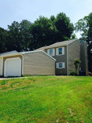 Super cute with city convenience in this 2 BR/ 1.5 Bath Townhome with a Garage!! Wood laminate floors through the foyer and living room. French doors to the deck. Newer exterior vinyl siding and roof. New Stove and New light Fixtures. Fireplace is for decorative use only, AS IS.