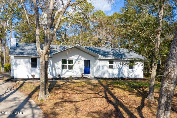 Come home to easy Southport living at this completely renovated home located just a short bike ride or walk from downtown! This immaculate home features an open floor plan with a large living room and flex space with lots of possibilities. As you walk in, you will be drawn to the fully-upgraded gourmet kitchen featuring new light fixtures, granite countertops, solid wood White Shaker cabinets, and stainless steel Whirlpool appliances. Enjoy peaceful evenings in your screened in back porch, or relax by the full wall fireplace. Additional features include a new roof, windows, HVAC and water heater, as well as new paint, carpet, ceramic tile, and luxury vinyl flooring throughout. A must see!