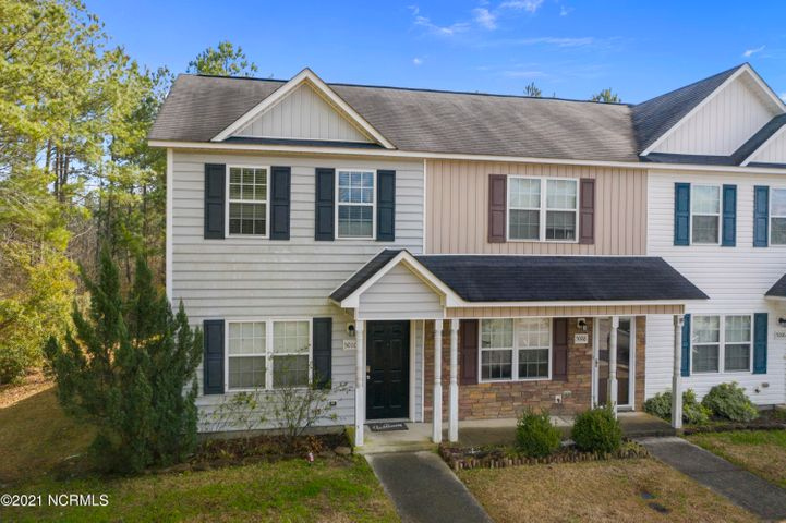 Wanting to enjoy the comforts of a home without the high maintenance? Look no further than 5010 Bannister Loop. Very sought after END unit! This townhome enters into an open living room and kitchen. Plenty of countertop and cabinet space. Near the kitchen is a half bath which makes great for guests when entertaining. Convenient laundry area that leads to the screened in porch and backyard. On the second floor are two bedrooms and bathrooms. Awesome opportunity for both investors or first-time home buyers!