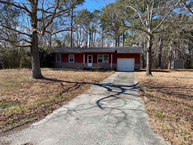 Calling all investors! NO HOA, NO city taxes, AND just 10 short minutes to the main gates of Camp Lejeune, this 3 bed, 1.5 bath is loaded with potential! Offering an attached one-car garage, a walk-in closet in the master suite, AND situated on almost a half acre with wood privacy! Get your showing scheduled today!