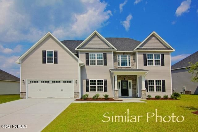 Welcome to the prestigious new home community, The Preserve at Tidewater. A coastal community. Brand new homes by Onslow County's most trusted and preferred builder, featured in Builder 100/ Top 200 Building firms in the country. This prominent neighborhood boasts a picturesque entrance, matured trees, spacious lots and a feeling of nature and serenity. Complete with an impressive clubhouse area and community pool. Introducing the Herndon B floor plan which features 4 bedrooms and 3.5 bathrooms at approximately 2,975 heated square feet. Situated on a gorgeous lot, the curb appeal is exquisite! Easy-to-maintain vinyl siding, accented by stone or brick. All surrounded by a sodded front yard with a clean, classic landscape. The spacious foyer welcomes you in, opening to the formal areas. Formal living room and formal dining room are perfect for hosting those spacial occasions. The chef in the family is sure to fall in love with the kitchen! Open and spacious with an ample amount of cabinet and counter space, and a bar for extra seating. Stainless appliances include a smooth-top range, microwave hood, and dishwasher. Enjoy your morning coffee in the breakfast nook. Gather everyone together for movie or game night in the family room. An expansive 24'x15', the family room boasts plenty of natural lighting, a ceiling fan, and a lovely fireplace, surrounded by marble and topped with a custom mantle. The impressive master suite is approximately 17'x14' with a trey ceiling, ceiling fan, and a 9'x8' sitting area. ''Get away from it all'' in the luxurious master bathroom. Two vanities topped with cultured marble counters, full view custom mirrors, ceramic tile flooring, separate shower and soaking tub, and a linen closet all leading to a HUGE walk-in-closet - you must see to believe!! Bedrooms 2, 3, and 4 are perfectly sized and prewired for ceiling fans. Bedroom 4 boasts a walk-in-closet and a full bathroom. Chores are made easier with separate laundry room upstairs. Entertain guests on the back covered porch - an ideal place to enjoy those Coastal Carolina evenings. 2 car garage to keep your vehicles safe from the weather. All backed by a one-year builder warranty from a top, local builder. Call today! NOTE: Floor plan renderings are similar and solely representational. Measurements, elevations, and design features, among other items, may vary in the final construction. Call to verify. Welcome Home.