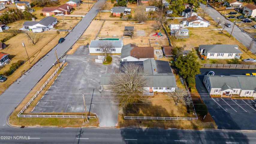 Large 1.2 acres of land with 142 ft of road frontage on Neuse Blvd centrally located in New Bern, NC. NCDOT annual average daily traffic count is 10,000 - 19,999. Property zoned C-3 and consists of 3 freestanding buildings totaling 5,944 sq ft. Front building was built in 1960, has 3,066 sq ft with 6 private rooms, 2 bathrooms, full kitchen & 2 heat pumps. Second building built in 1989, has 1,628 sq ft with 3 private rooms & heat pump. Third building was built in 1991 with 1,250 sq ft with 1 large open room, 1 bathroom & heat pump. Property has direct access on Neuse Blvd & Phillip Avenue. Entire property is fenced in. Property is within a minutes drive of Carolina East Hospital, restaurants, shopping, residential housing & Hwy 70 accesses. Has 17 parking spaces & covered drive up area. Utility provider is City of New Bern. Property is ideal for medical or professional office or can easily be torn down to optimize the entire 1.2 acres of land for its highest & best use.