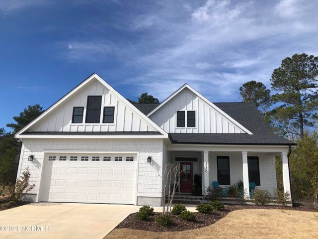 This beautiful four-bedroom, two and a half bath home is built by Streamline Developers and highlights the coastal design with beautiful, upgraded features. With the owner's suite on the main floor, it really emphasizes the gorgeous views this community has to offer! The owner's suite features an en suite bath with double vanities, a walk-in shower, and tons of closet space. The great room conveniently flows into the kitchen and casual dining area with access to the back porch! The kitchen is fully equipped with all stainless-steel appliances, upgraded cabinetry, and a large island.  Upstairs you will find a bathroom with double vanities and three additional bedrooms, all amply sized with closets and amazing view! Epoxy flooring in garage and mini split Heat/AC in garage. The gorgeous design features coupled with the trendy coastal design truly makes this house a home! Two year leaseback is required. Call your REALTOR(r) today to schedule your tour!