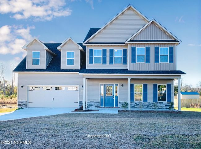 Atlantic Construction is now building their affordable homes in Sewell Fields of Verona! The Charleston plan features 2149 heated square feet & the space to meet your needs both upstairs and downstairs! The ground level has a spacious living area with a gas fireplace, a large kitchen with a pantry, & a formal dining room. The upstairs owner's suite features a trey ceiling with not one, but TWO walk in closets, double vanity sinks, and a separate soaker tub and walk in shower in the bathroom. The other two bedrooms share a bath, and the bonus room might be the perfect spot for a home office, game room, or play room for all those toys! There's a minimal HOA and no city taxes in this community, and you are just a short drive from MCAS New River, Camp Lejeune, Stone Bay, or the beaches of Topsail Island. Act quickly and you can pick the colors you want to suit your own style! These affordable homes are close to everything but far from expensive! Plus the builder is offering $4000 in closing costs with an acceptable offer and a comprehensive warranty. Call a Realtor today for more information on this brand new home! The garage will be on the LEFT!