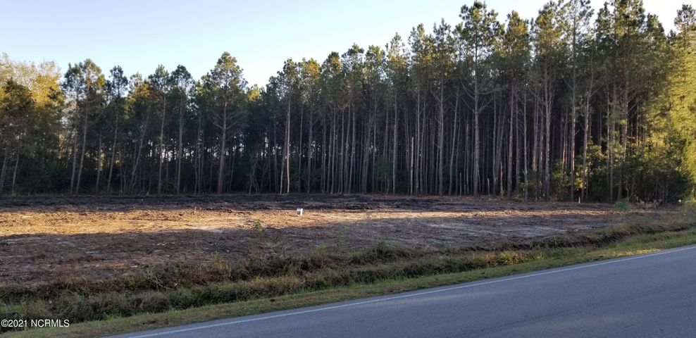 Hard to Find Residential Lot- 1.76 acres with 1 acre Cleared.  Build Your Dream Home in this Perfectly Located  Country Setting with Plenty of Room to Spread Out.  Doublewide / Modular Homes Welcome. Easy Ride within Minutes of Camp Lejeune, Swansboro, Jacksonville, and Area Beaches .