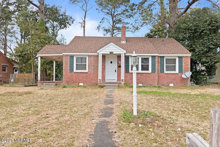 Timeless Classic!  Beautiful brick home in the heart of Jacksonville. 3 bedroom 1 bath home in a convenient location. Original wood flooring in the main living areas and NO CARPET! The home invites you in with newer paint, a perfectly cozy fireplace and updated kitchen cabinetry. The home has a lovely porch and fenced in back yard complete with storage shed. Perfect starter home or potential rental!