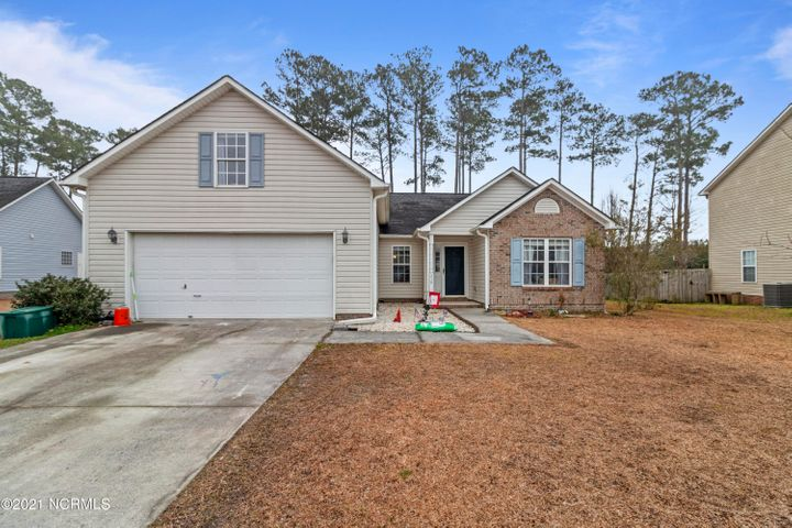 Welcome to Carolina Forest! 210 Burning Tree Ln sits nestled surrounded by nature's beauty and nearby amenities. Carolina Forest is known for its convenience, a few miles from the beaches, short commutes to military bases, shopping centers, public golf courses, and so much more. It's only a brisk walk from Carolina Forest Elementary, New Beginnings Child Care, and grocery store not too far. The seller is offering a $5,000 flooring allowance to the buyers, enabling one to modify the home to your liking and have it like new. This house has a low maintenance yard and a large backyard deck with a bar for entertaining friends and family. A fireplace that will keep the home warm and feeling cozy for the family to enjoy. This home has a split floor plan so the master is separate from the other bedrooms so you can enjoy peace and quiet. If you're looking for an extra room for an office or game room, you'll fall in love with the bonus room overlooking the street. If this is a home that catches your attention, don't delay, schedule your showing today!