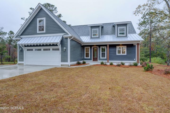 Welcome home to the Savannah Floorplan! You won't believe your eyes in this stunning 3 bedroom + Bonus, 3.5 bath Farmhouse Style Home with tons of upgrades! This gorgeous coastal home is sure to steal the curb appeal of the neighborhood! Enjoy an open concept living room with sleek laminate tiled floors, vaulted two story ceiling and cozy gas logs fireplace, open to the stunning kitchen with large island and eat-in dining, front office or den, and large laundry room. The kitchen provides access to a rear deck with outdoor fireplace, cooking station and cathedral ceiling overlooking a pergola in the beautiful back yard. This home boasts main level living at its finest with an oversized master suite located on the main level featuring a gorgeous coffered ceiling and master bath boasting a free-standing soaker tub, tile surround walk-in shower, separate vanities, and two walk-in closets! Upstairs you will find two more spacious bedrooms that share a full bath, and a huge 21X12 bonus room with full bath. Summerhouse on Everett Bay features 6 scenic lakes and community amenities include two gated entries into the community, Resort style community pool with lazy river, two tennis courts, breathtaking clubhouse, boat launch with direct access to the intracoastal waterway including day docks and pier, on-site boat storage, picnic areas, nature park with fire pit, walking trails, open air pavilion, playground, and fully equipped fitness center with lockers & showers. Perfectly located between Wilmington and Jacksonville and just minutes from MARSOC, Camp Lejeune, Topsail Beaches, and Stone Bay. Come home to extraordinary coastal living at its finest!