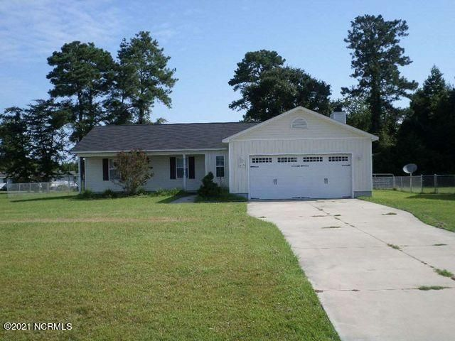 Are you ready to live the quiet life while still being close enough to necessities? You won't want to miss 205 Wingspread Ln! Located in Beulaville, you are within minutes of Mike's Farm and a short drive to Richland. There are 3 bedrooms and 2 full baths. The owner's suite has trey ceilings and has 2 closets. The kitchen has matching black appliances that includes a french door refrigerator, a built-in microwave and dishwasher. The living room features a wood burning fireplace and is separated from the kitchen by a breakfast bar. Enjoy the summer weather on the front porch or in the completely fenced in backyard. Don't miss your chance to own this home!