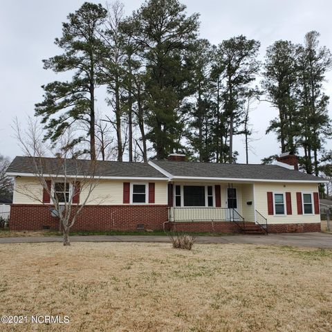 Charming home, includes new windows, roof, siding. Covered back porch 12x40. Original wood floors everywhere except kitchen, baths (tile) family room (new carpet) utility room.Three bedrooms, family room, living room, dining room adjoins family kitchen with nook.Fireplace has wood burning stoveSold ''AS IS'' SELLER WILL NOT DO ANY REPAIRS'