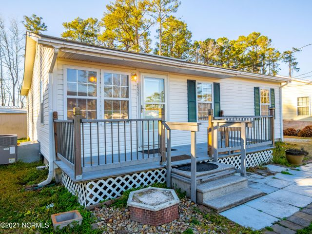 Amazing As-Is Home Opportunity For Both Owner Occupants & Investors!!  Large Front Deck Welcomes You To This Wonderfully Warm Home With A Sizable Living Room, Roomy Kitchen, Expansive Laundry Room & 3 Comfortable Bedrooms.  Bathroom Has Been Upgraded With A Big & Super Convenient Walk-In Shower.  Shower Features Multiple Shelves & Brace Bars!  Kitchen Boasts A Steel Refrigerator & Range With Lovely Wood Cabinetry.  Extra Large Laundry Room Comes With A Washer & Dryer!!  Rear Yard Features A Shed With Covered Front Porch, Kennel & One Extra Vinyl Shed For That Much Needed Additional Storage During Your Move!  Lakewood Drive Is Less Than A Block Away From Jacksonville Fire Station #2.  Just 2 Blocks Away From Western Extension & Lowe's Foods.  Lakewood Drive Is Also Just A Short Walk Away From Jacksonville High School & Walgreens.   Talk About An Amazing Location!!  Schedule Your Showing Today & WELCOME HOME!!!