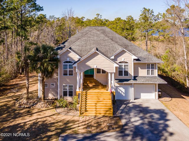 Beautiful waterfront property with exceptional views will soon be available in the sought out community of White Oak Crossing . This large 3500 HSF plus home offers great living space and flexibility for those families that like their privacy, have extended family needing separate living space or simply families that want huge entertaining  areas . Open floor plan with a chef's kitchen and breakfast nook ,  separated dining, office / den and offering split bedrooms really is a crowd pleaser .  Wow, what a screened in deck all the way across the home which over looks  your own private water views on almost two acres with wild life galore. No flood insurance required , but all the perks. You may install an observation dock for small craft per CAMA that is on a tidal creek looking out to the White Oak River . Larger boat? , no problem, White Oak Crossing offers a boat ramp and day dock along with storage and a community pool .  This community is 4 minutes from historic Swansboro and 10 minutes to Emerald Isle beaches, 20 minutes to Camp Lejeune, 30 minutes to Cherry Point .  This is truly a great opportunity to buy it all at an affordable price. Huge 2 door garage with Tandum parking for 4 vehicles and lots of storage . The walk out downstairs offers huge flexible living space with a full bath . The owners have done many upgrades and repairs which make this home ready to move in and love . Will be available to see March 5th , so call for appointment and a list of upgrades .