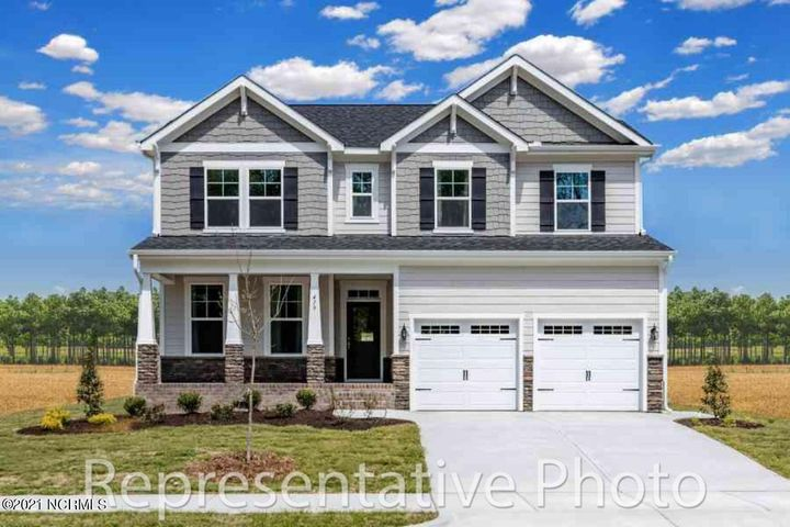 Welcome to the ''Trillium''. This plan features 4 bedrooms, 2.5 baths and a separate loft area. Notice the openness of this floor plan on the main level with a two-story family room, formal dining room, kitchen with huge island and eat in area, laundry room and main level master bedroom. The Master Suite has a trey ceiling, walk in closet, a bath with dual vanities, garden tub and separate tile shower. The second-floor features three additional bedrooms, a loft, a full bath with double vanities and walk in storage area. Rounding out with a 2-car garage and covered front porch and a back patio. This plan ''packs a big punch'' for the square footage.
