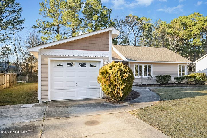Beautifully  updated  Hunter's Creek home, conveniently located close to the front of the community for easy in/out access. This large 1753 sqft 3 bedroom/2 bath home is situated on an oversized .27 acre lot with privacy woods to the back (no immediate  back door neighbors!). As soon as you walk in the front door you will love the open floorplan with new beautiful wood LVP flooring and carpet throughout. Opulent family room with glass-enclosed fireplace leading to a bright sun room. Fabulous kitchen with breakfast bar, tons of bright white custom cabinets and brand-new counter tops. The large primary bedroom features a large walk-in closet next to the new vanity. Two secondary bedrooms are generously sized with large closets. House is capped by a brand new architectural shingle roof, with skylights and roof replaced in 2020. Only a 5 minute commute to Camp Lejeune's main gate, shopping and great schools! Schedule a viewing today as this listing will not last long!