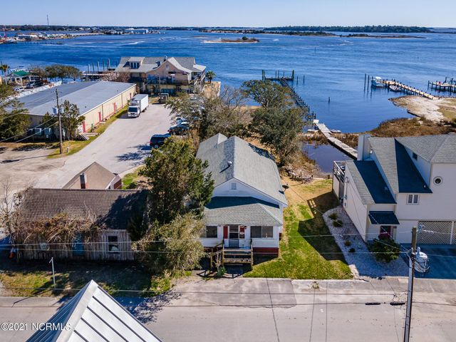 COMMERCIAL, WATERFRONT, RESIDENTIAL ALL IN ONE! Great opportunity to own a business and live in down town Swansboro on the water! This property is truly unique with the zoning which offers a range of businesses and living options. This is an old home being sold as is. Open a bar, rent kayaks or jet skis, live above your business, or simply lease a space. The zoning is truly a blessing for an adventurous entrepreneur seeking to change their life. Look at the Town of Swansboro B2 historic overlay PDF on the site for the list of businesses. Just think, you can watch the boats traveling down the ICWW, sleep, eat and make a living from the same spot! Call for an appt.