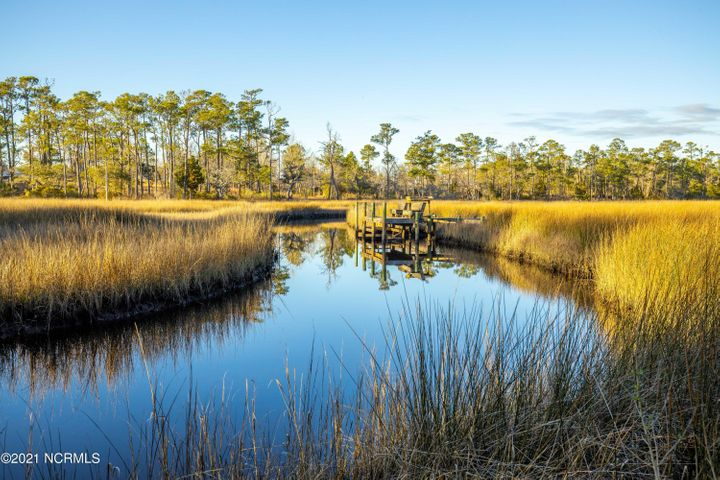 Now is your opportunity to build your dream home on this highly desired waterfront lot in Swansboro!  With over an acre, you'll enjoy a cleared lot that still maintains a great balance of mature landscaping all while nestled up to the creek.  Not only are you in the heart of Swansboro, you can enjoy all of the perks without city taxes! Spend your days overlooking the pristine calming views. You have the opportunity to install an observation dock for small craft per CAMA on the tidal creek into Halls Creek.Don't let this one pass you by!Don't miss the opportunity to have it all!