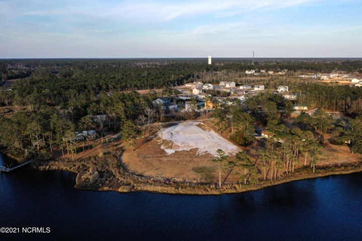 Rare 1.9 Acre ''ready to build'' waterfront lot located in Starkeys Cove on the White Oak River. This quiet, private community consist of only 5 homes and this beautiful lot. The property is just a short drive to shopping, golf, and the Crystal Coast Beaches. It is also located in the highly desirable Carteret County School District. City water available with a 4 bedroom septic permit on file. Don't miss out! Call to schedule your showing today!