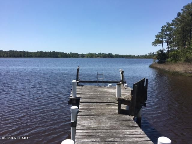 Enjoy the serenity of a secluded lot on Queens Creek with a private pier. Four bedroom septic system installed on Creek front lot. 328 Ace Lane 9 has active 4 bedroom septic permit (lot 14 & Pt 15, 0.78 of an acre) & 320 Ace Lane (Lot 19, 0.35 acre) are included with this offering. Does not want to sell lots individually.