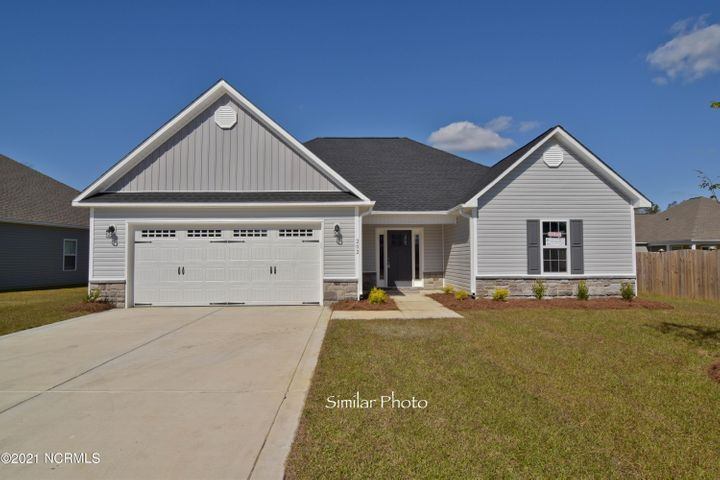 Welcome to Jacksonville's hottest new community, Stateside. Located off of Gum Branch Road behind Stateside Elementary School. All new construction by Onslow County's most trusted and preferred Builder featured in Builder 100/ Top 200 Home Builders in the country. Stateside is 16 miles to Camp Lejeune, 12 miles to New River Air Station and minutes to area schools and shopping. A beautiful new community for active and growing families.  Introducing the  Ashby with Bonus Floor Plan! This home offers plenty of room with 3 bedrooms, 2 bathrooms, a bonus room above the garage at approximately 2093 HSF. The outside of the home is easily maintained with vinyl siding, accented by stone or brick. The front yard is sodded with crisp classic landscaping. The porch is welcoming and opens into the homes foyer.  Through the foyer the home opens up into a large living room with double trey ceiling, ceiling fan, and a corner fireplace surrounded by marble and topped with a custom mantle. The chef in the family is going to fall in love with the kitchen. The kitchen is open to the large living room and dining area. The kitchen comes complete with a pantry, plenty of counter and cabinet space, an island for extra seating and a stainless steel package to include a dishwasher, microwave hood, and smooth top stove. The master bedroom is a great place to escape to with the large walk-in closet and master bathroom with a double vanity, tile flooring, and separate shower and soaking tub. The house also includes a covered back porch, a great place to enjoy your morning coffee, or BBQ on those Carolina evenings. A two car garage, the best place to store your vehicles away from the weather. All backed by a one-year builder warranty from a top, local builder. Call today!NOTE: Floor plan renderings are similar and solely representational. Measurements, elevations and design features, among other things may vary in the final construction. Call to verify. Buyer to verify schools. Welcome Home.