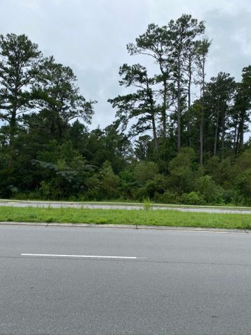 Beautiful partially cleared lot with wooded boundaries.  130 feet of road frontage on Piney Green.  Country Club Acres with Piney Green access.  Ready for you to build your dream home!