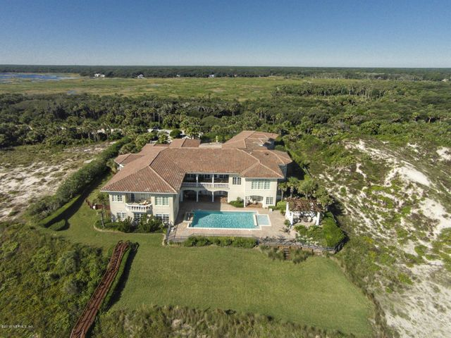 11,300 sq ft plus 4 car garage, 2.13 acres and 315 ft on the ocean in private area of Ponte Vedra Beach yet close to shopping, golf and schools.