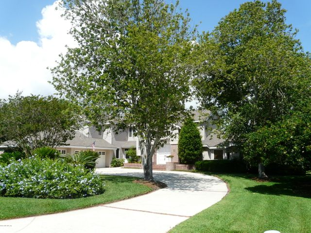 Beautifully-landscaped, with semicircular drive & 3-car courtyard style garage
