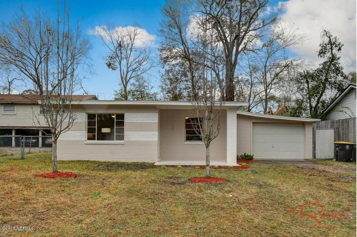 Traditional Florida appeal, presenting with concrete block construction and a new composite shingle roof and two young crape myrtles to welcome you home!