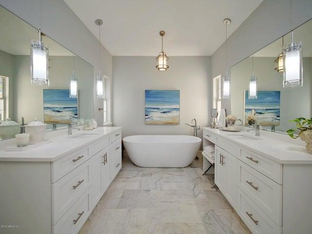 Stunning updated master bath with split vanities.