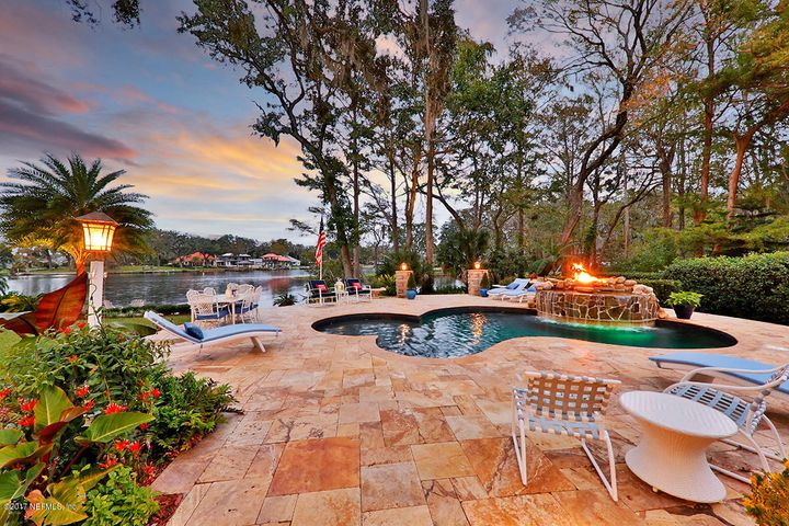 Enjoy the heated pool year-round, with a propane fire pit and waterfall feature.