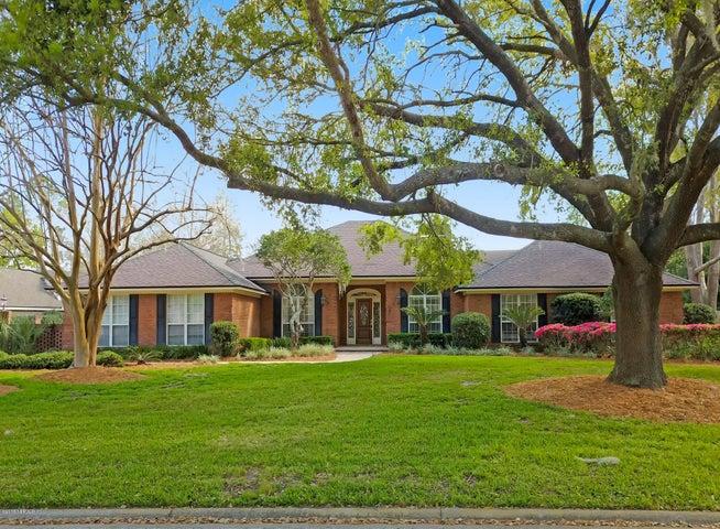 Beautiful manicured lawn with Oak and azaleas.