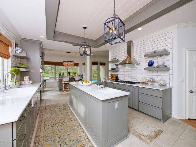 Kitchen with Large Working Island and Open Shelving
