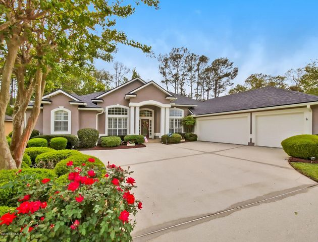LOCATED ON A PRIVATE CUL DE SAC HOME SITE AND BACKING TO PRIVATE WOODED PRESERVE.